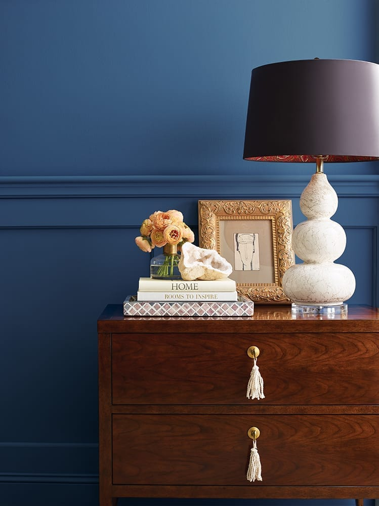 close up of tabletop accessories against an inviting blue wall with chair rail detail
