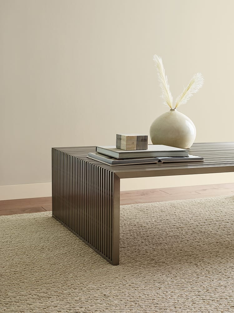coffee table with accessories against tan wall