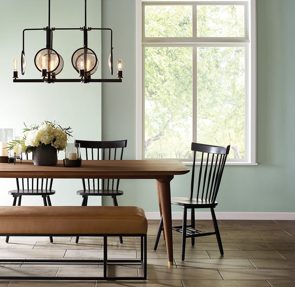 light green walls featured in a farmhouse-inspired dining area