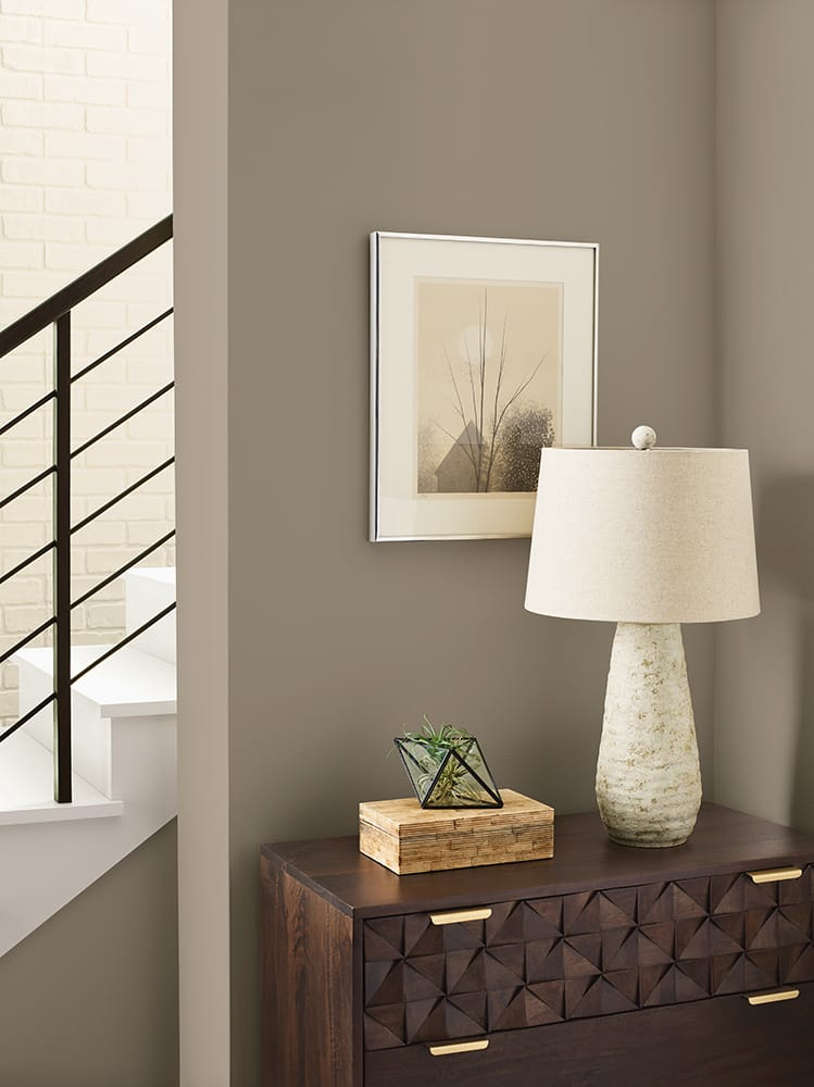 entry nook with tan walls, unique wooden table and tabletop accessories