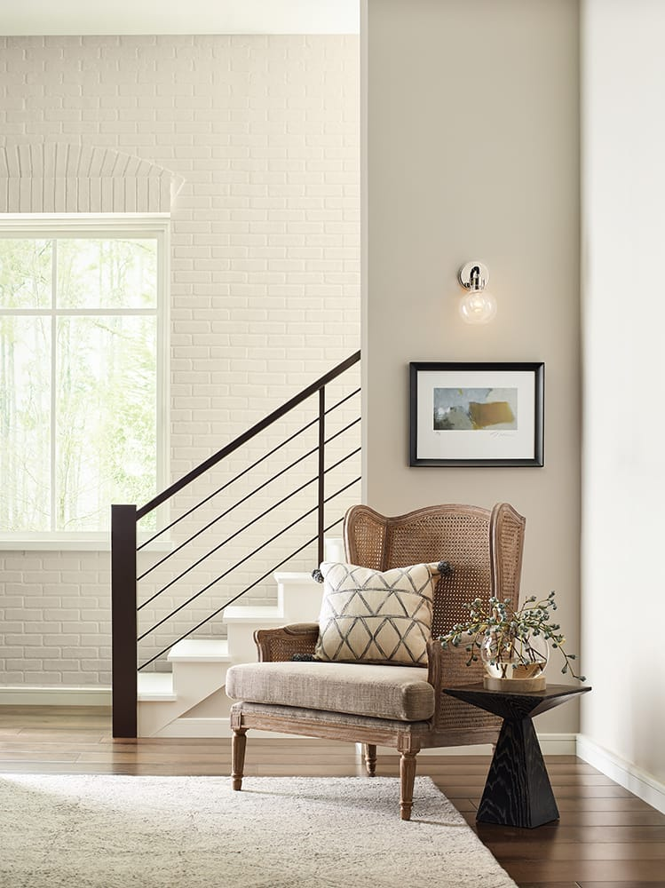 accent chair and side table in entry