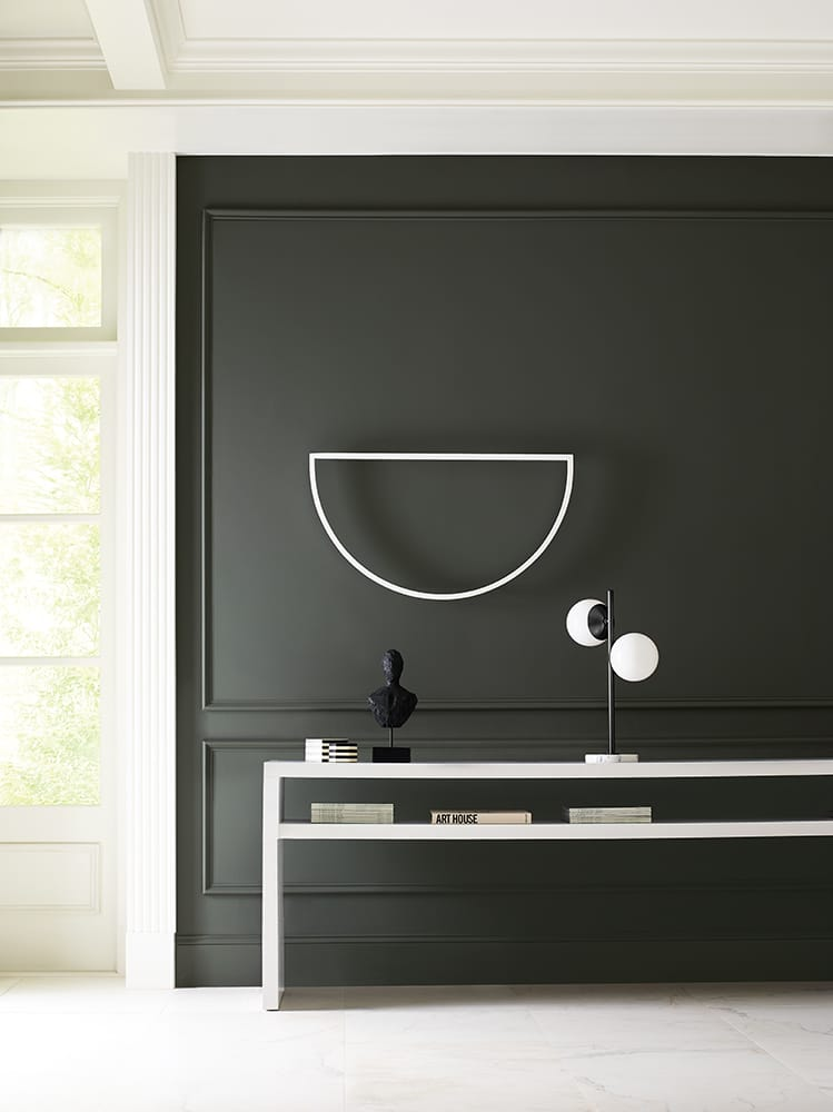 home decor on modern console table against charcoal accent wall