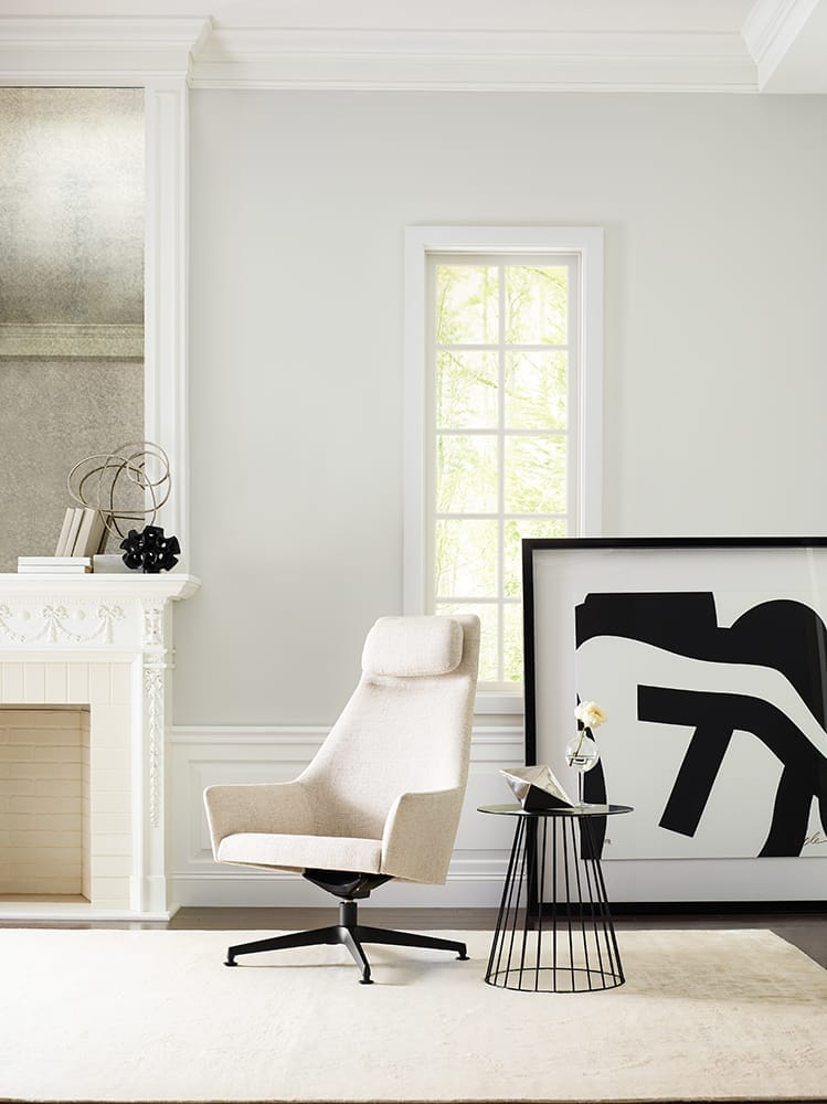 modern living room with accent chair, large scale artwork and cream walls
